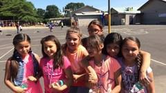 Students posing for the camera on the blacktop.