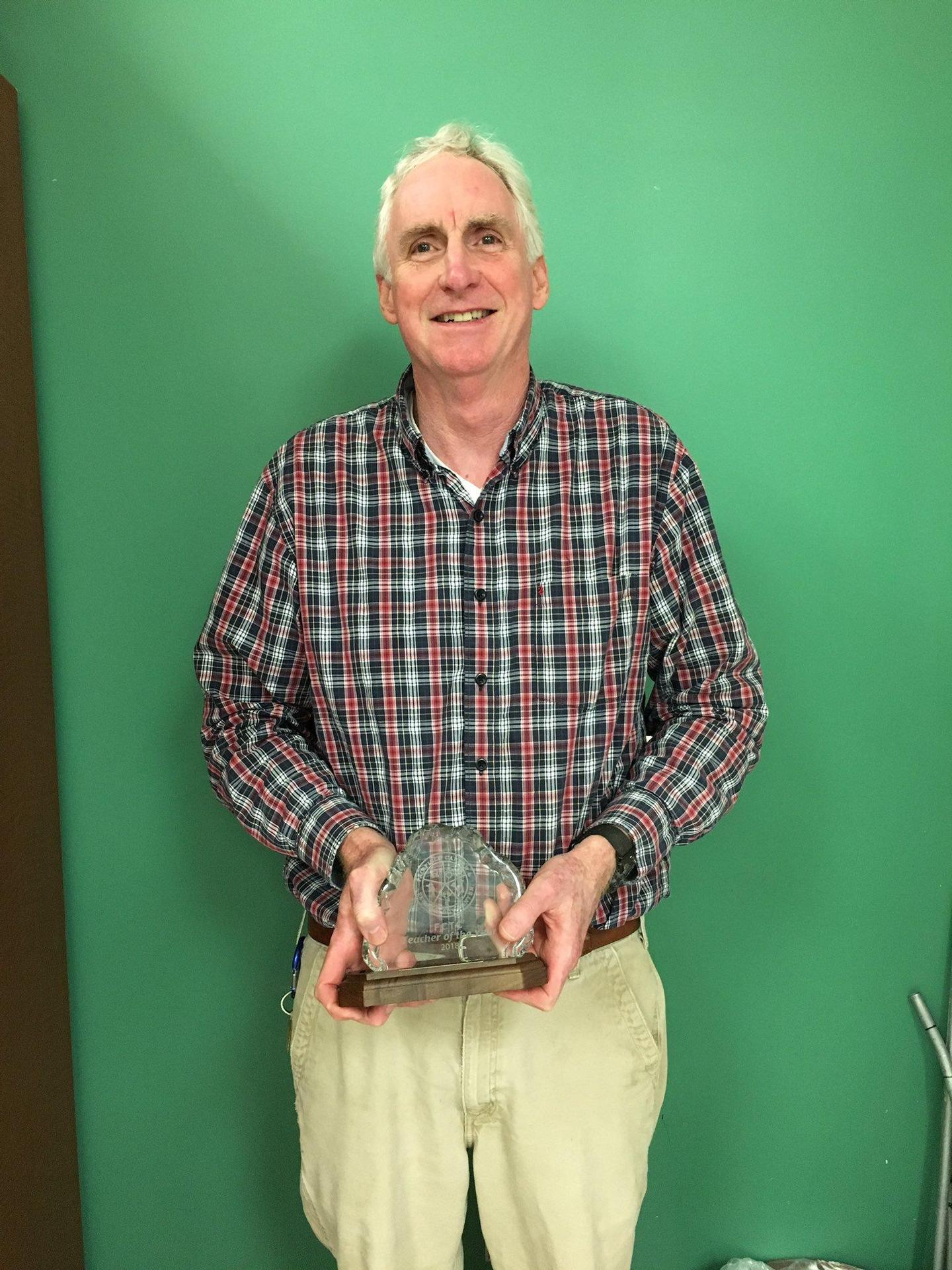 Mr. Johnson holding his TOY Award
