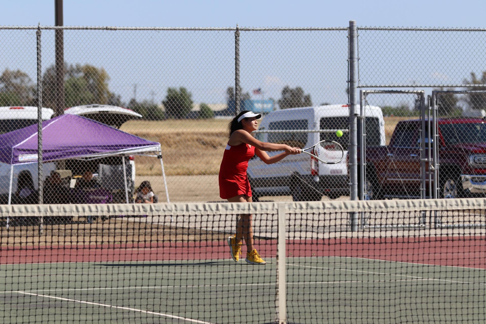Tennis players in action vs Washington Union