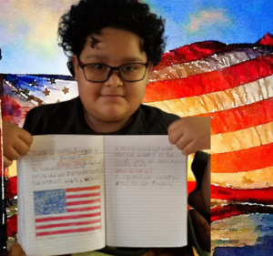 Student holds his notebook in front of American flag backdrop
