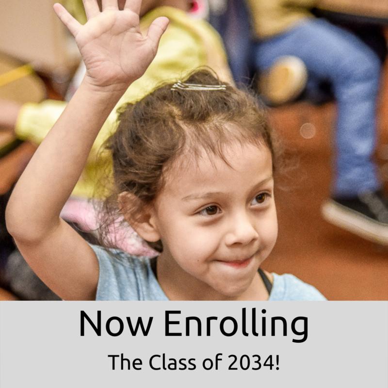 Female kindergartner raising her hand -- Now enrolling the class of 2034