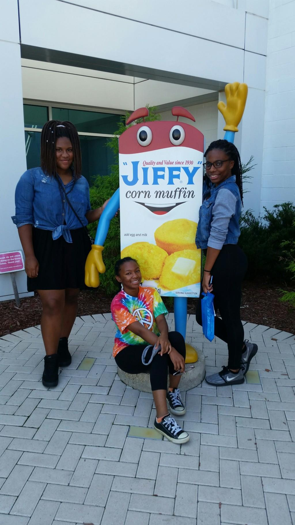Students posing with the Jiffy box mascot, Corny.