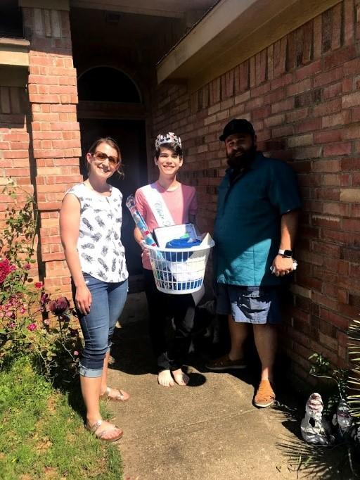 3 people with basket of goodies