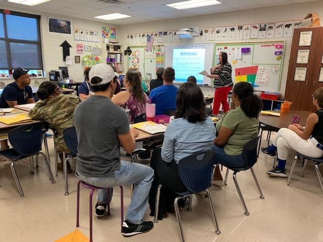 Teacher explaining APTT to parents