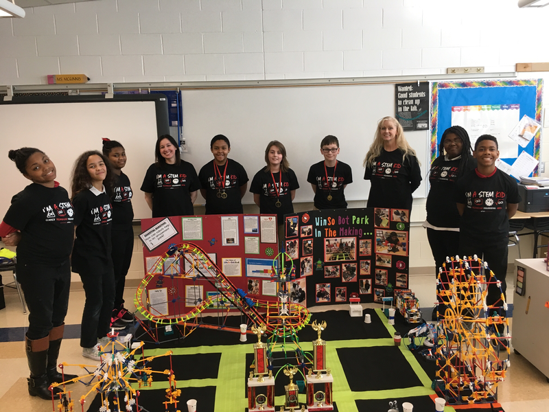 Team McNerds 2.0 posing with their project and robot