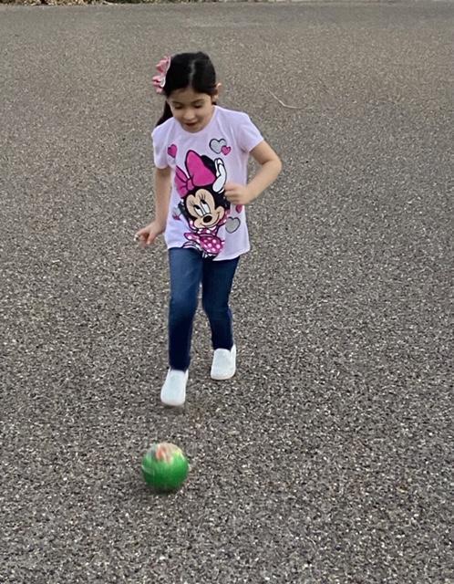 running and kicking a ball