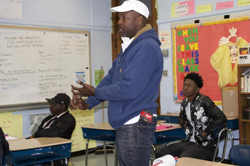 a teacher speaking to students