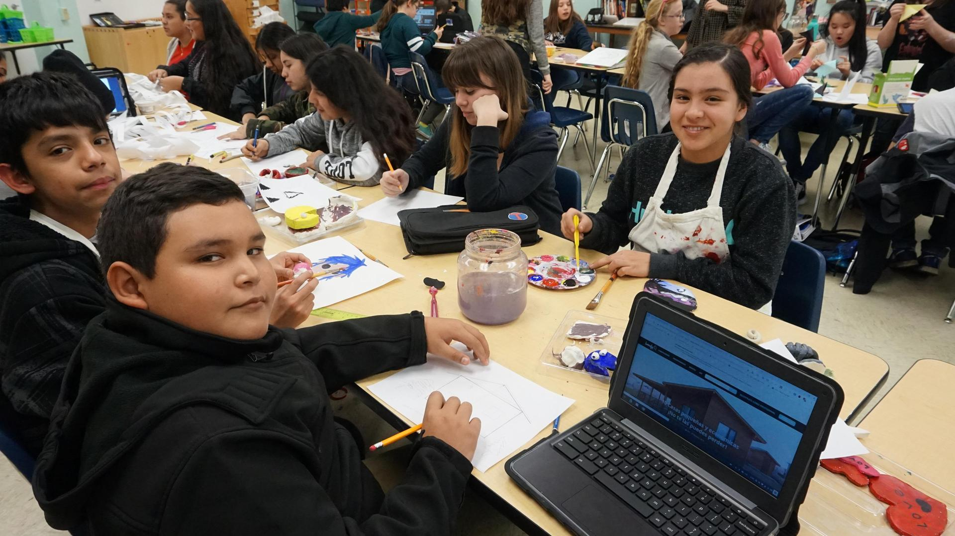 Multiple students working on art projects