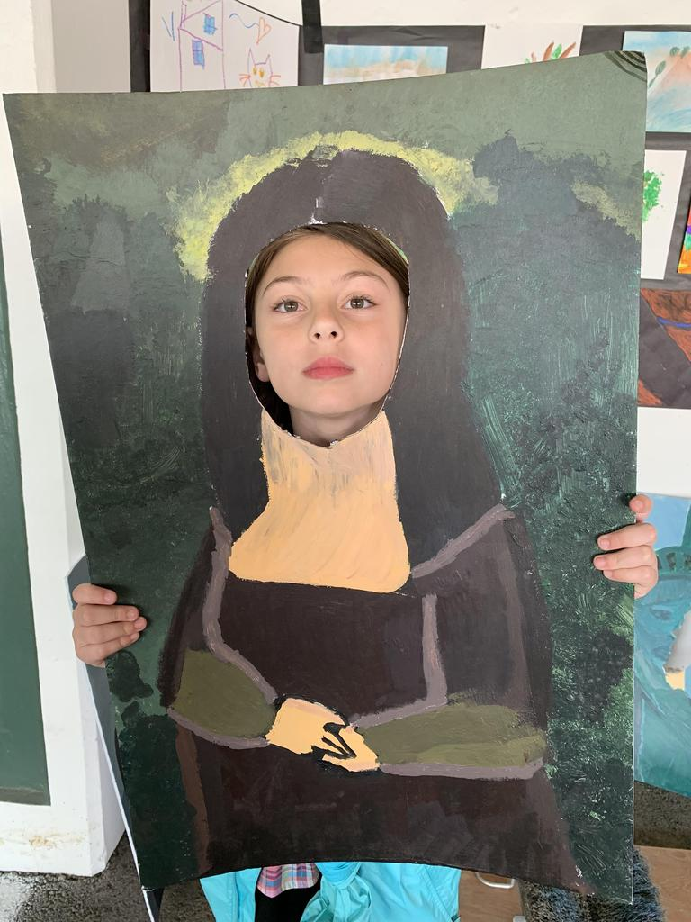 child posing in mona lisa painting