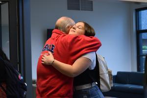 man hugging girl