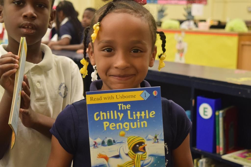 NASD Board member and Superintendent Give Students a Book