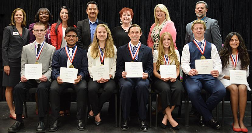 STUDENT OF THE YEAR: Seated: James Black III—KMA; Daniel Lomboy—LHS; Taylor Ogden—LHS; Nathan Strong—TCHS; Micole Marietta—TCHS; Timothy Jakell—EHS; Sheryl Ghoubrial—EHS. Standing: Sally Myers, founder; Dr. Judy White, Riverside County Superintendent of Schools; Mayor Natasha Johnson, City of Lake Elsinore; Juan Saucedo, LEUSD Trustee; Mayor Vicki Warren, City of Canyon Lake; Heidi Matthies-Dodd, LEUSD Trustee; Kim Joseph Cousins, President/CEO, LEVCC.