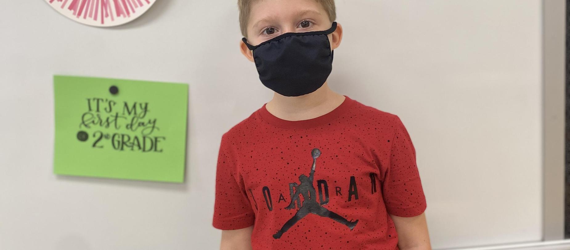 boy wearing a mask