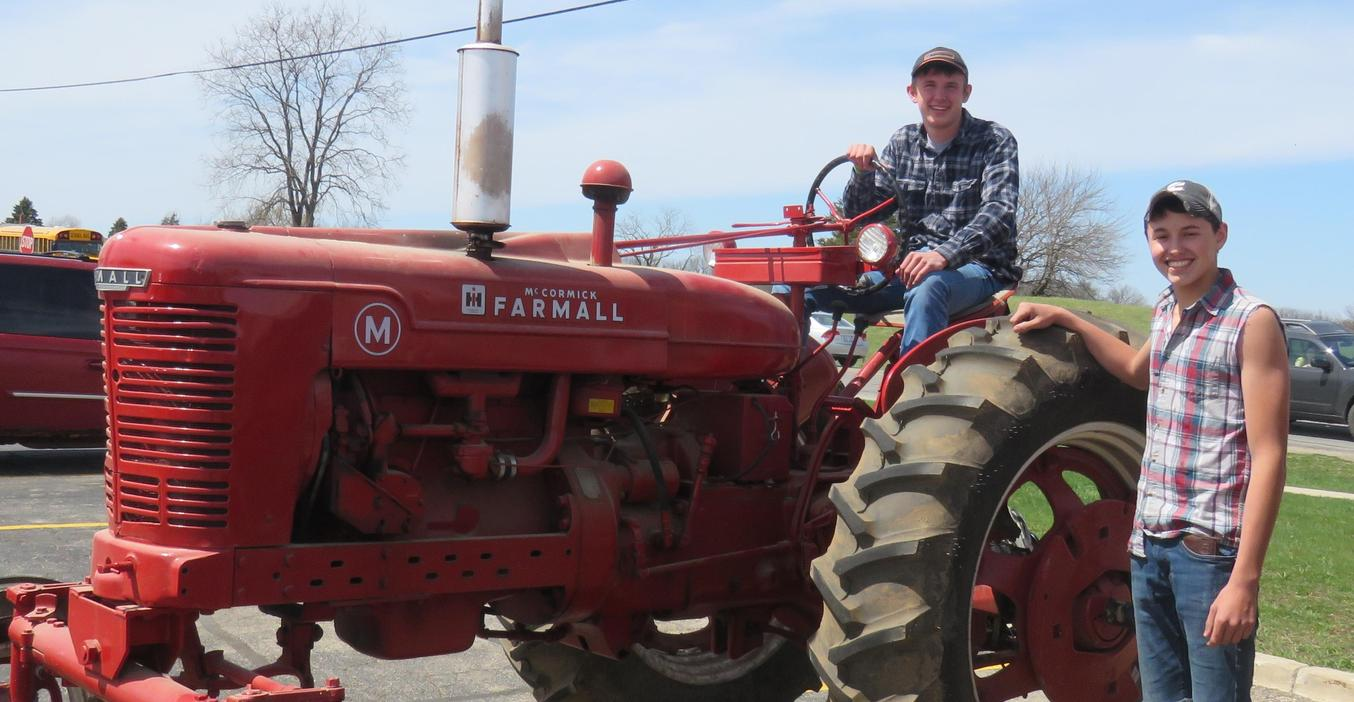 TKHS students drive their tractors to school for farmer day.