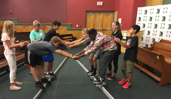 Students work together on a team building skill.