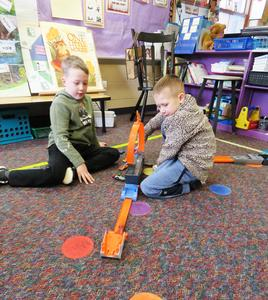 These boys had a great time playing with their Matchbox cars and track.