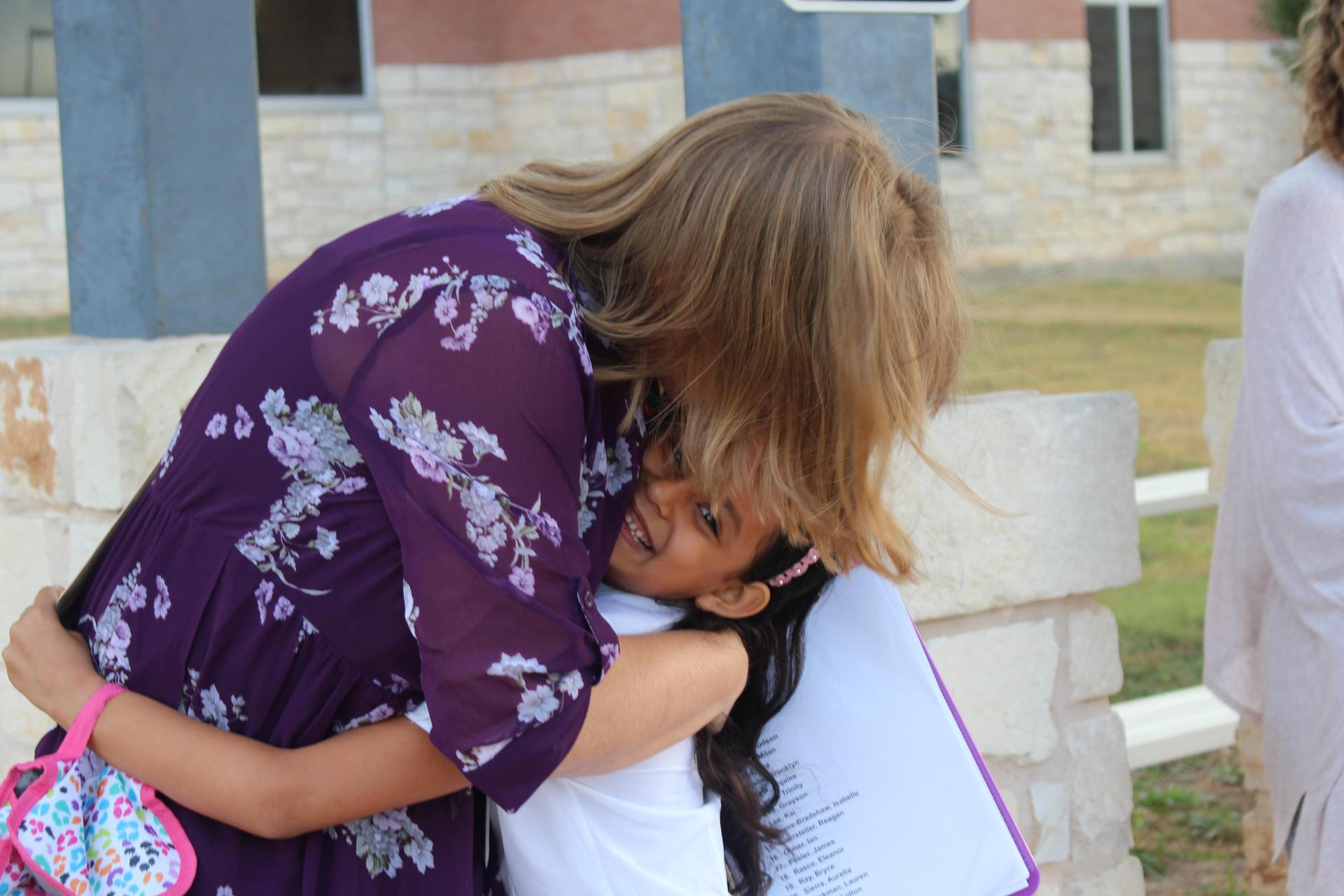 Student Hugging Teacher