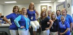 Administrators, Secretaries, Counselors, Nurses and Support Staff Showing Their School Spirit