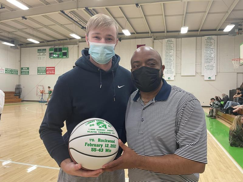 Blaine with Coach Bertram holding 1000th point ball.