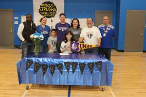 Liliana Gonzalez with her family, coaches, and principal