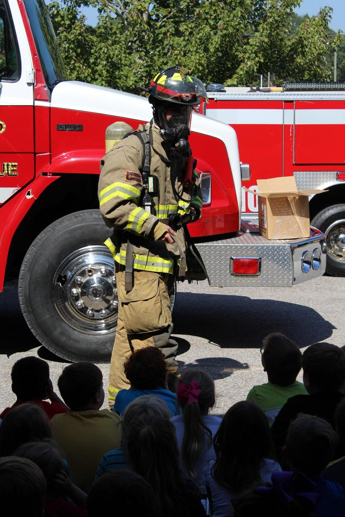 fire fighter with suit on
