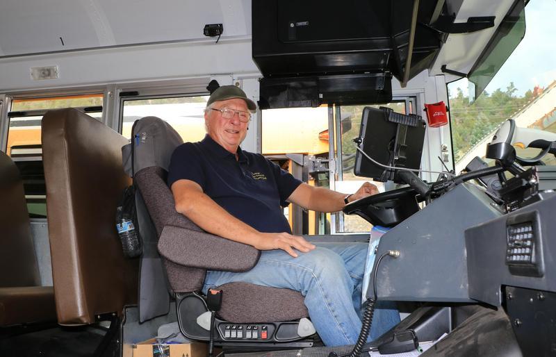 Steve Lee in bus driver's seat