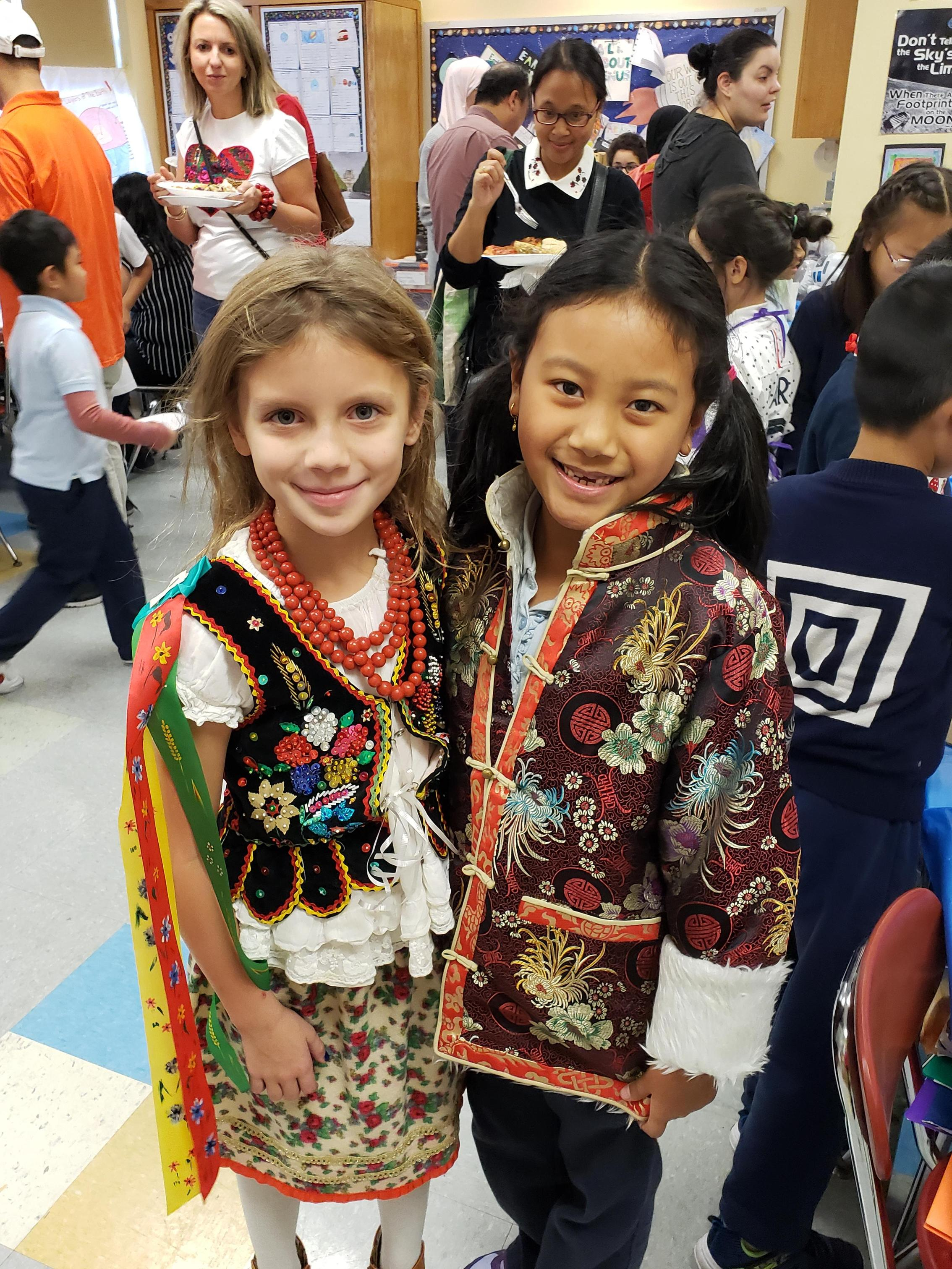 2 students in traditional garb