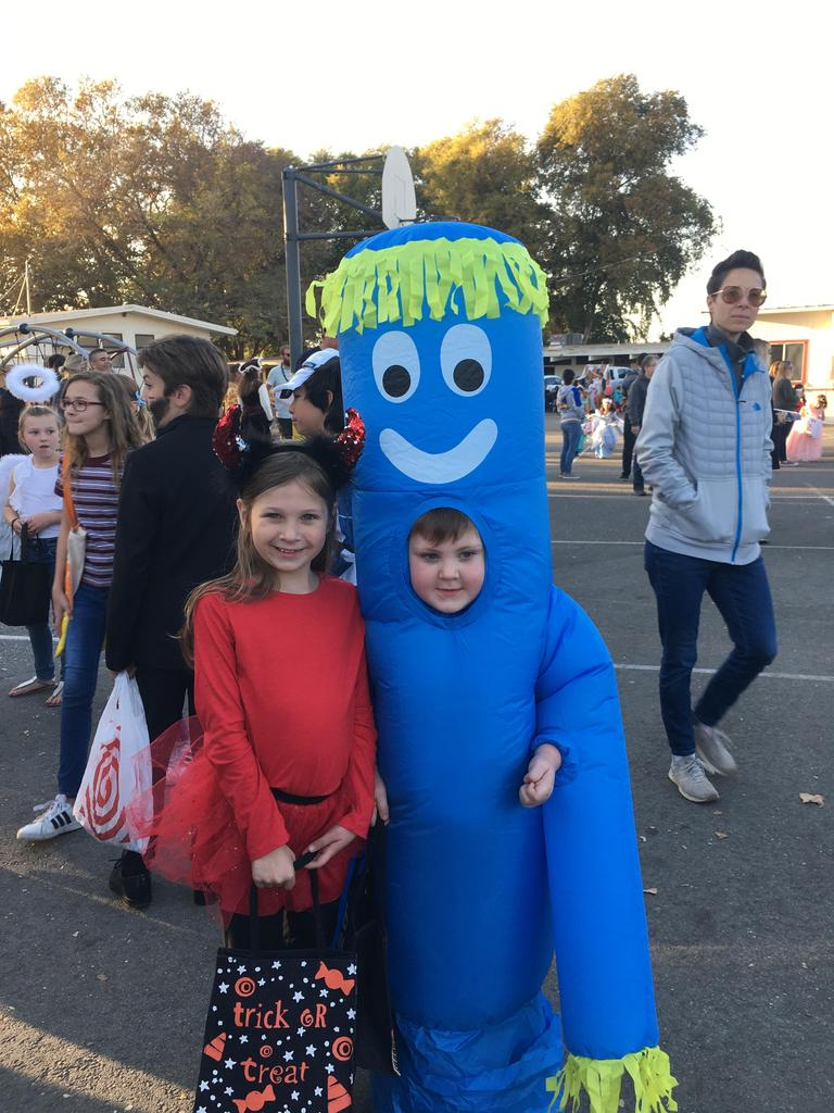 Boy and girl dressed in halloween costume