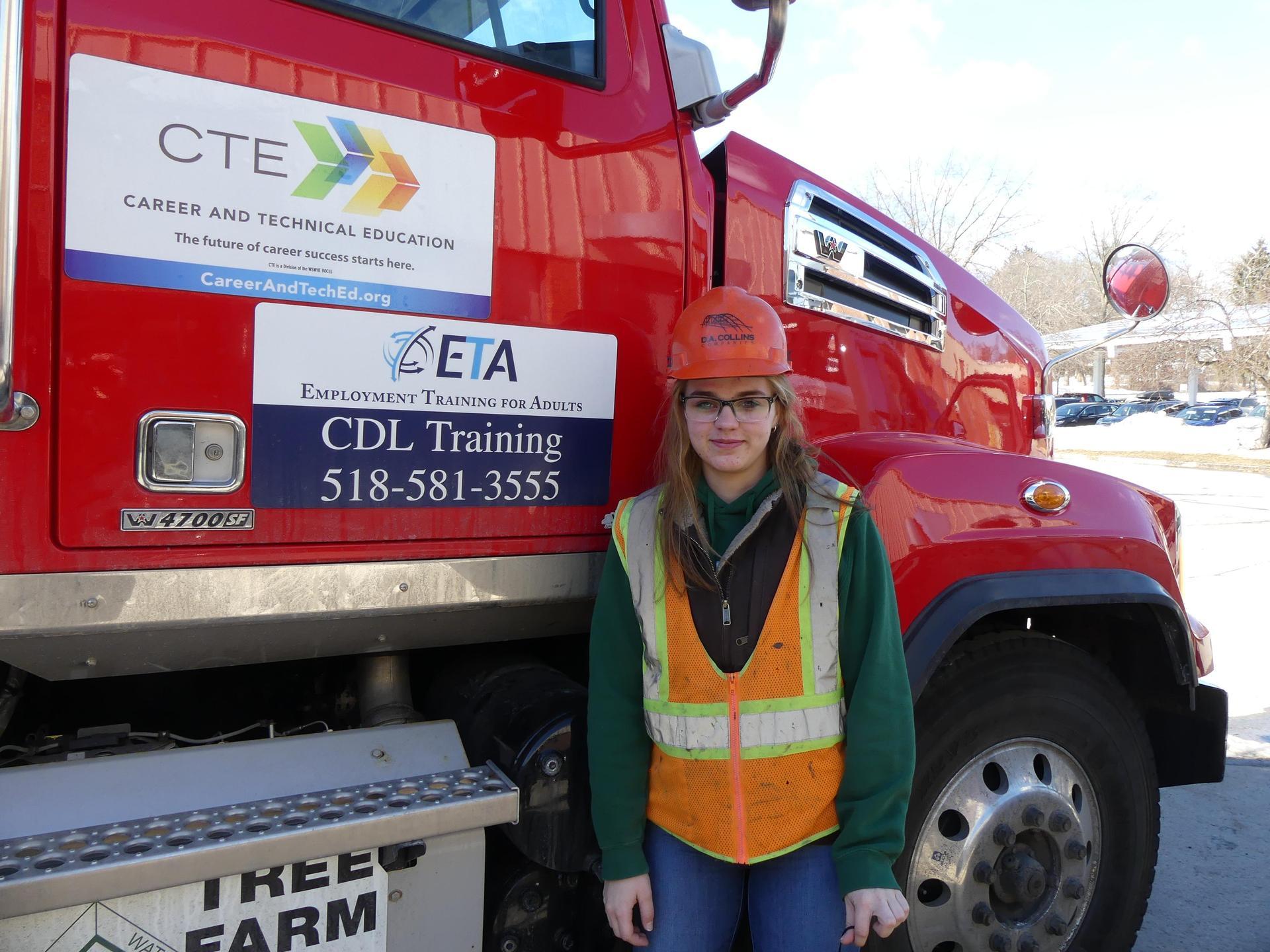 Amber Flynn next to dump truck