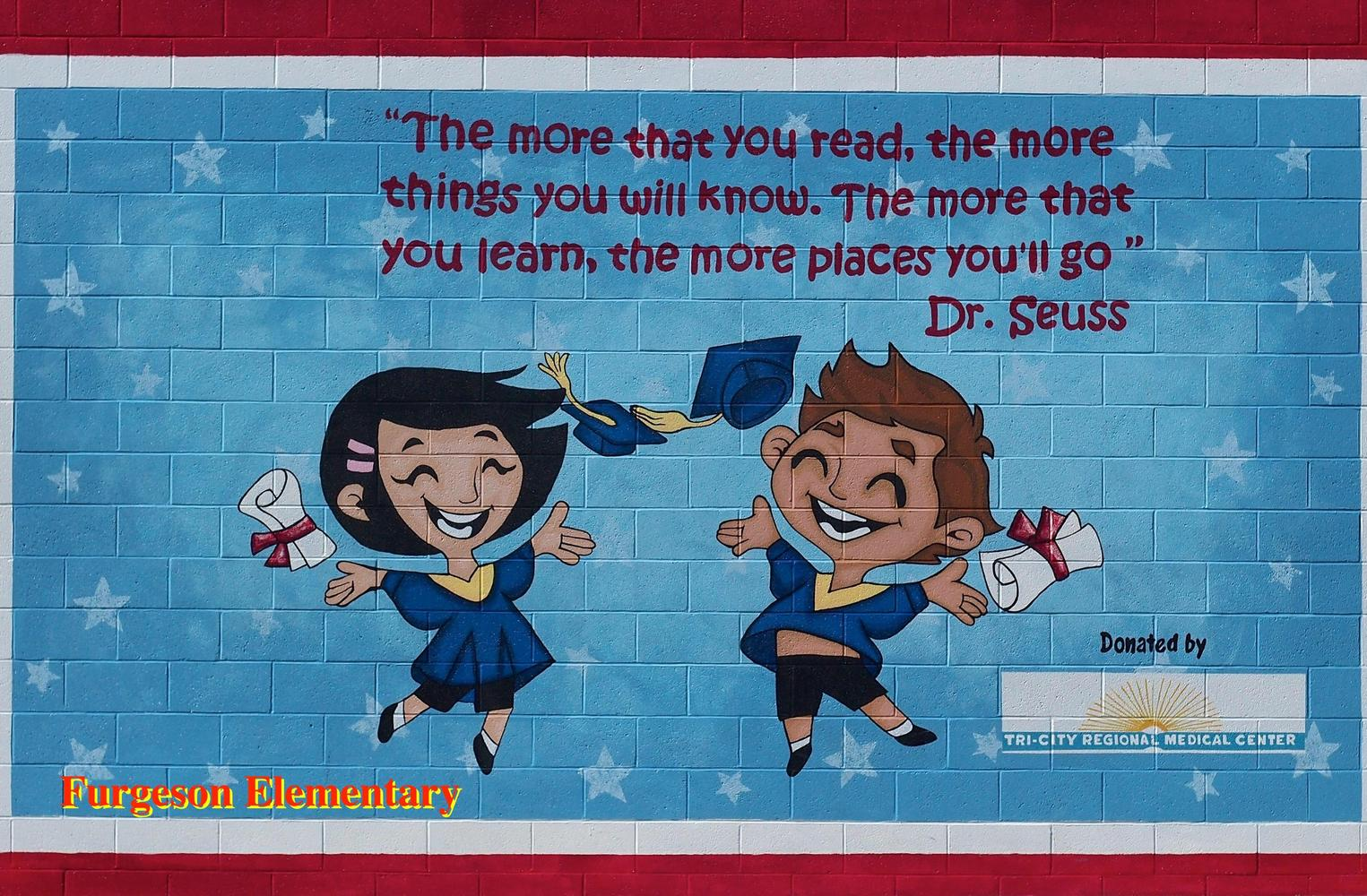 picture of handball wall with picture of boy and girl with Dr. Seus quote