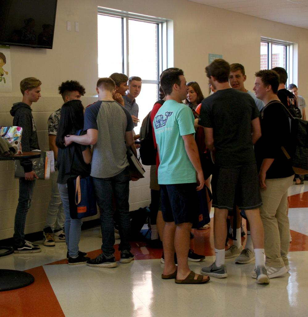 Students socializing on the first day of school at West Wilkes High School.
