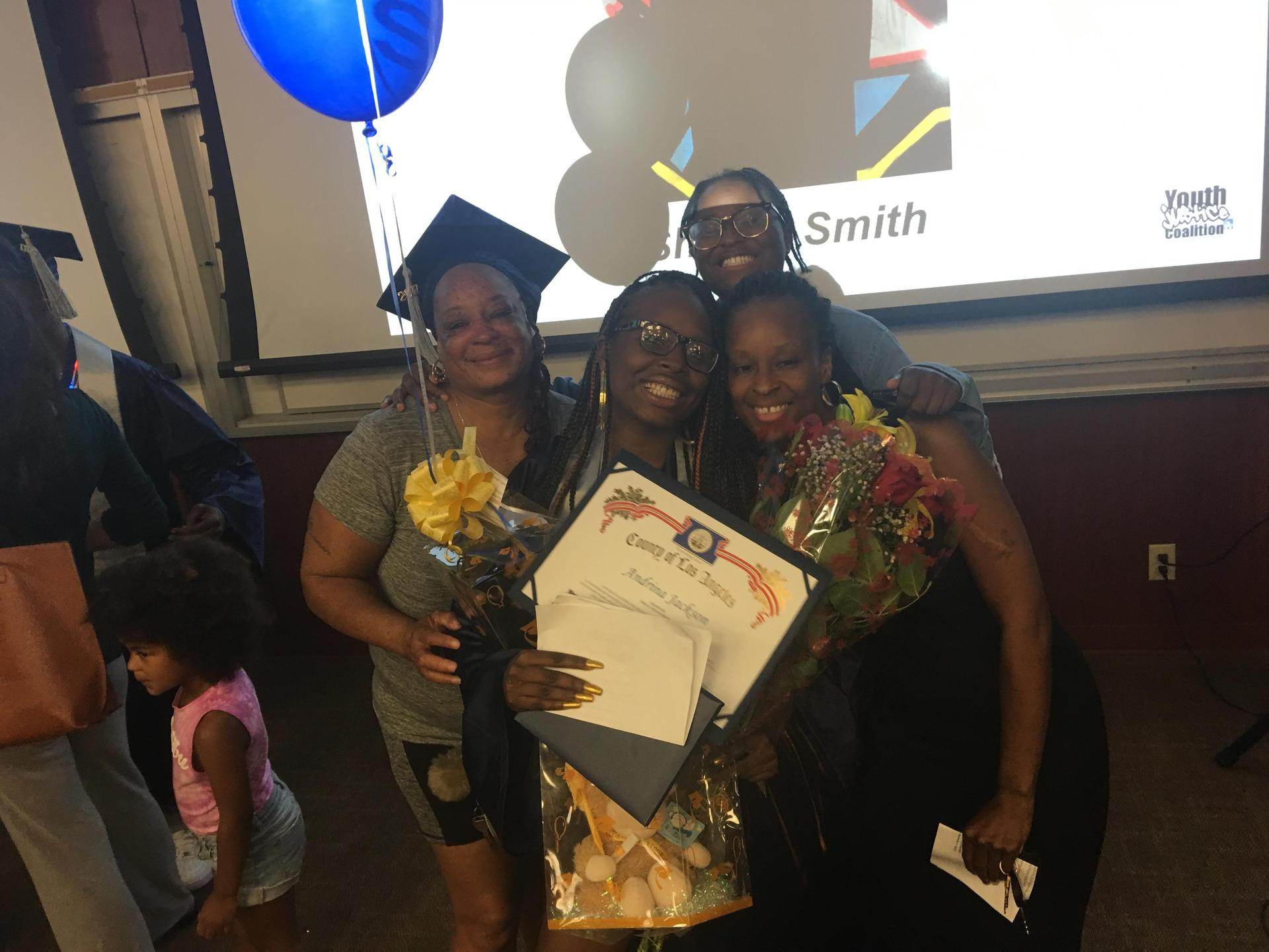 a YJC grad and her family