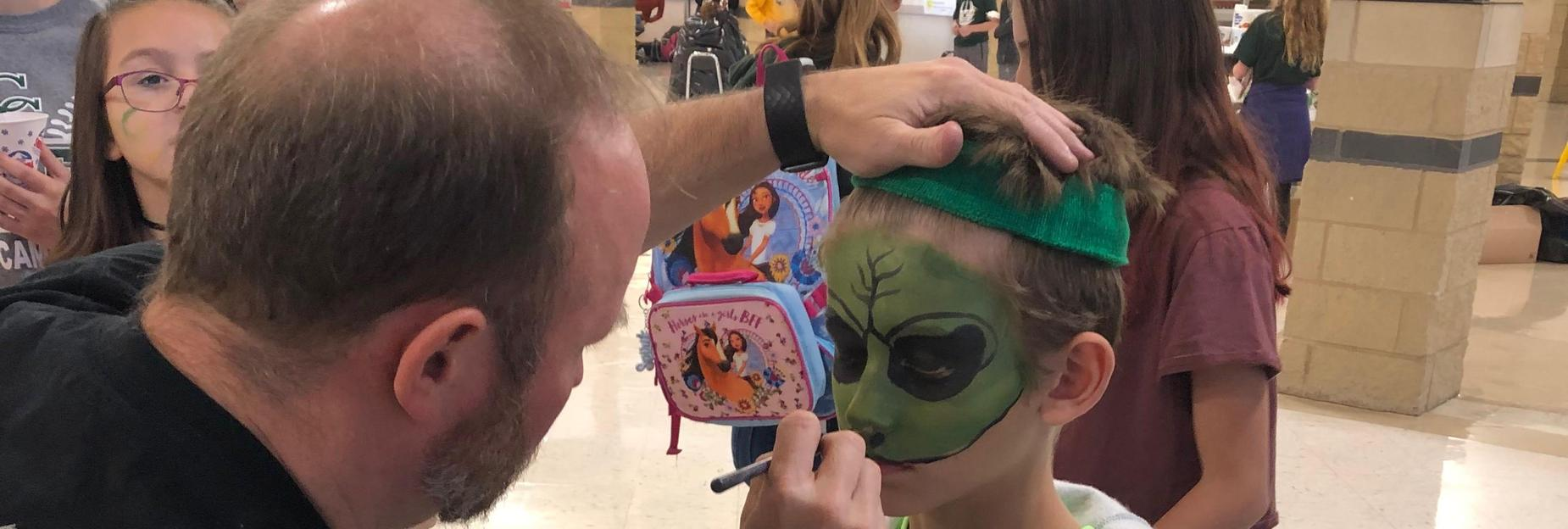 face painting at fundraiser