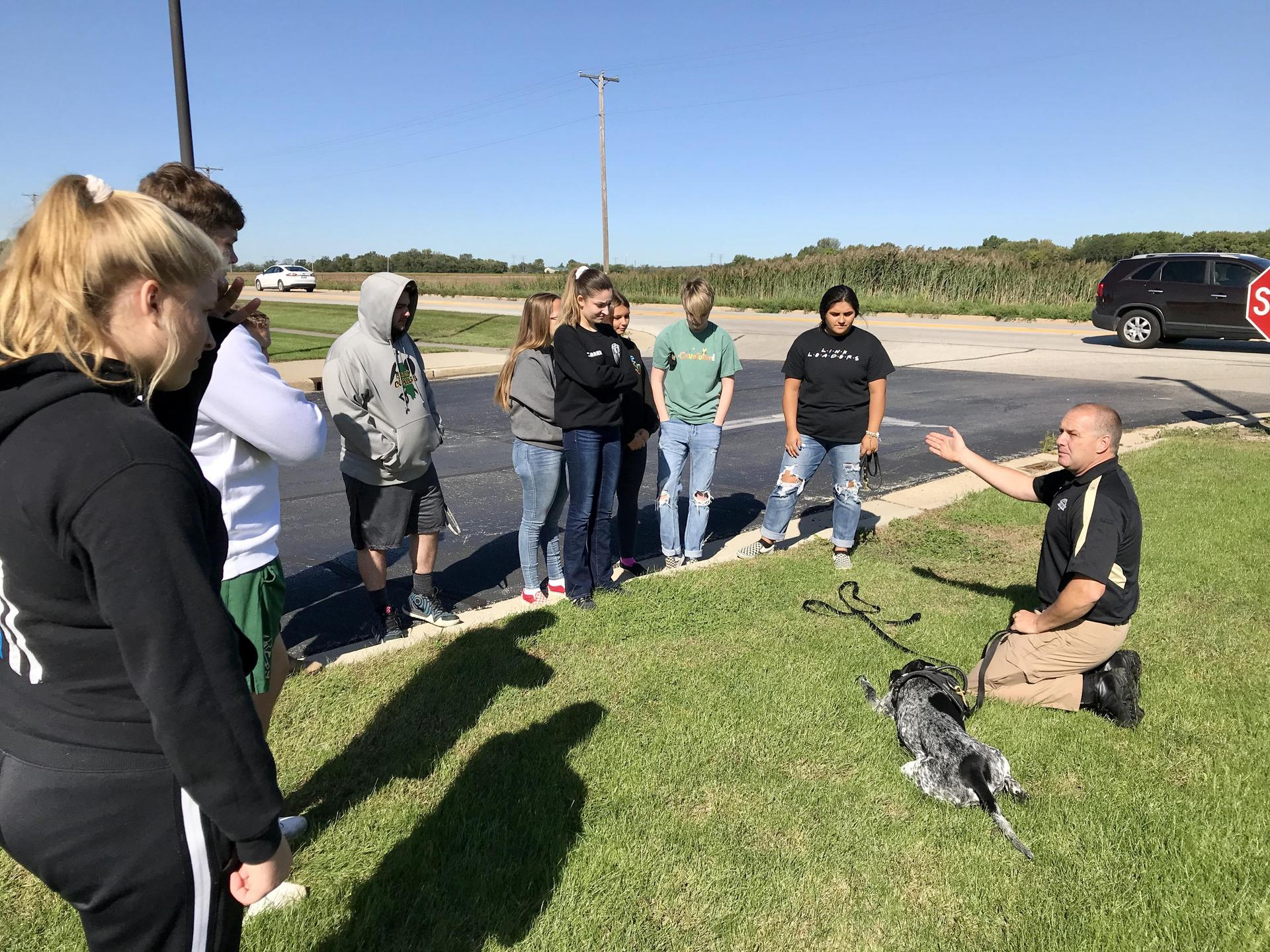Officer Coldwater demonstrating police K-9 techniques