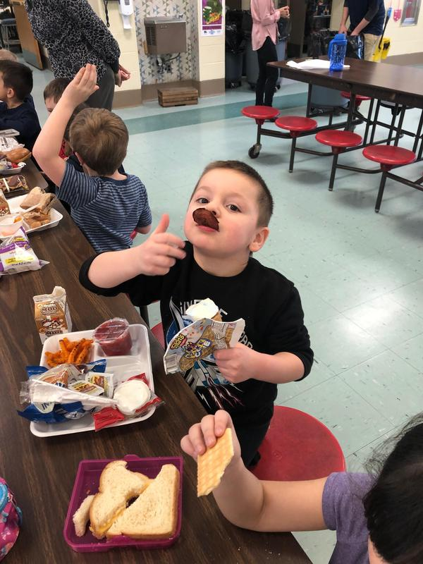 A boy tasting a beet chip.
