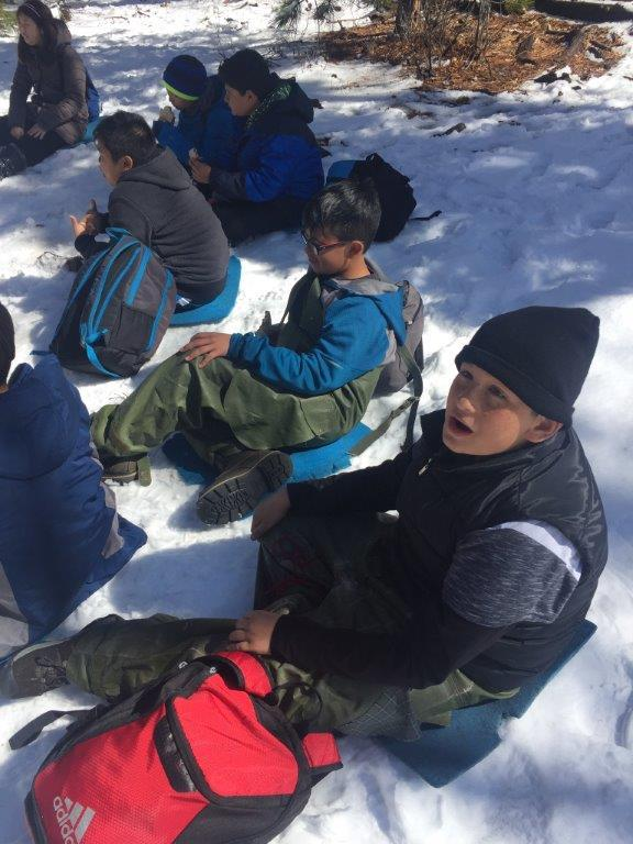 Students eating lunch in snow