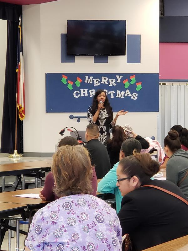 Mrs. Al-Tabatabaie presenting