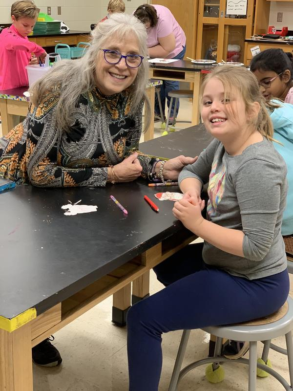 A grandparent volunteers in James River Day School's STEAM lab.