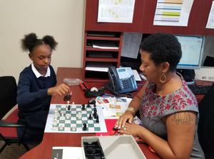 Karen Harkness playing Chess with Student