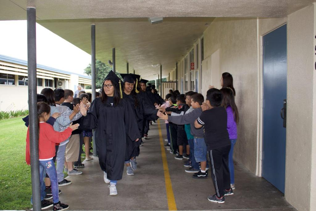 Seniors being greeted by Magnolia Students