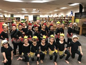 Pictured are Captain J. Castro Elementary Rhythmic Raider Dance team preparing for their dance number for the audience.