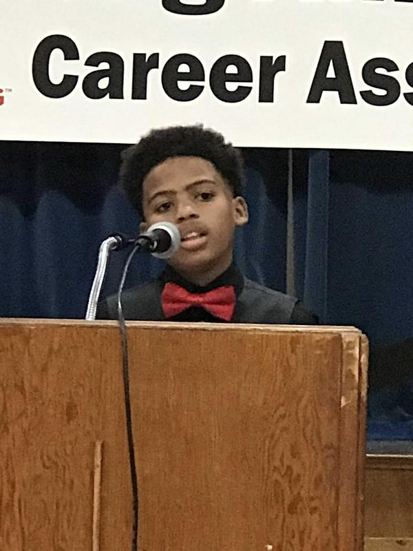 photo of newest member of the Baker Middle School JAG addressing the audience from the podium