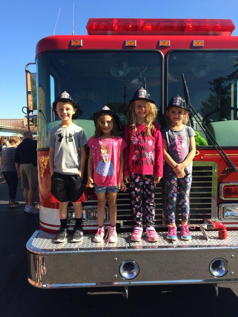 Fire Truck with 4 students in fire hats