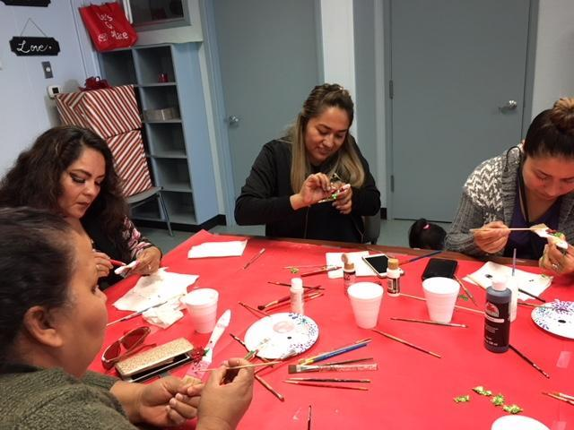 Parents participating in the winter craft