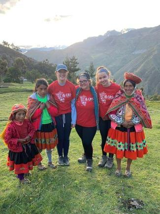 Peru group with native family