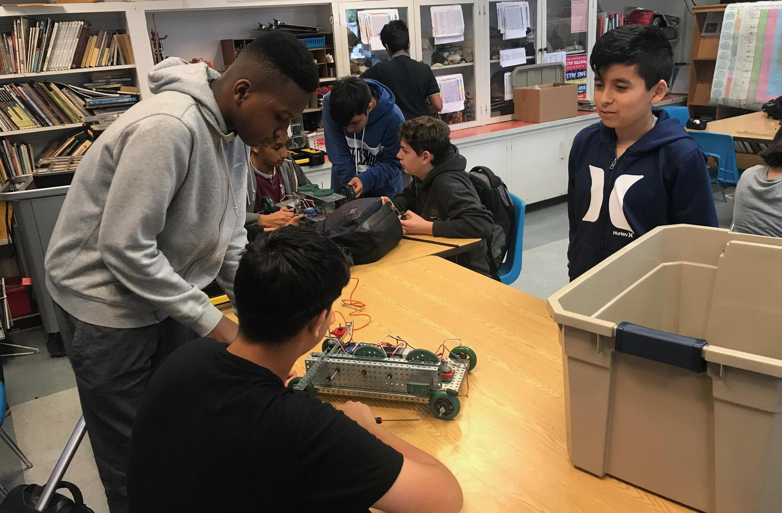 students show car built at robotics class