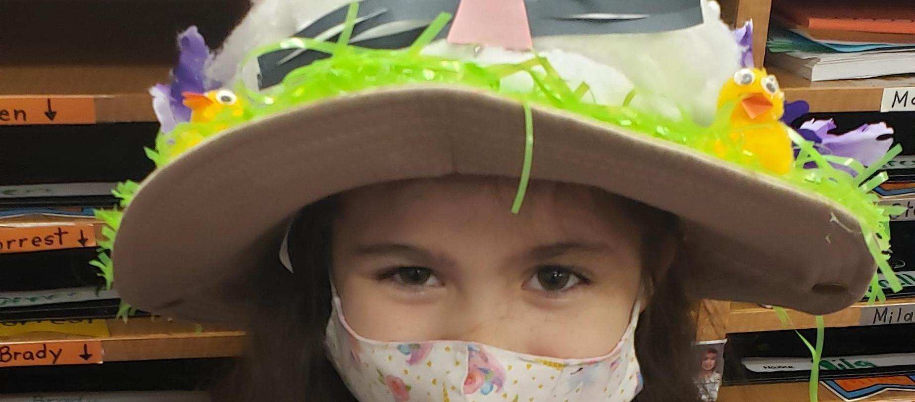 girl wearing an easter bonnet