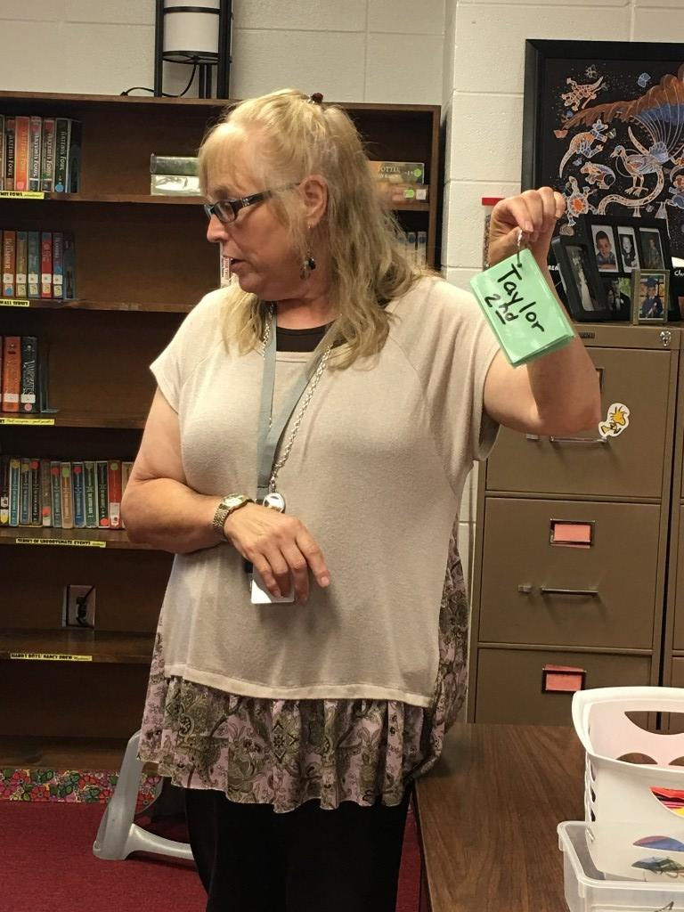 Mrs. Haney explaining about their barcodes.