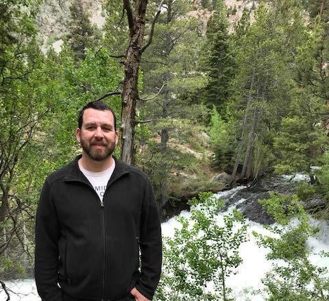 Photo of Mr. Ramirez standing in front of a small waterfall, Mono Lake, Ca.