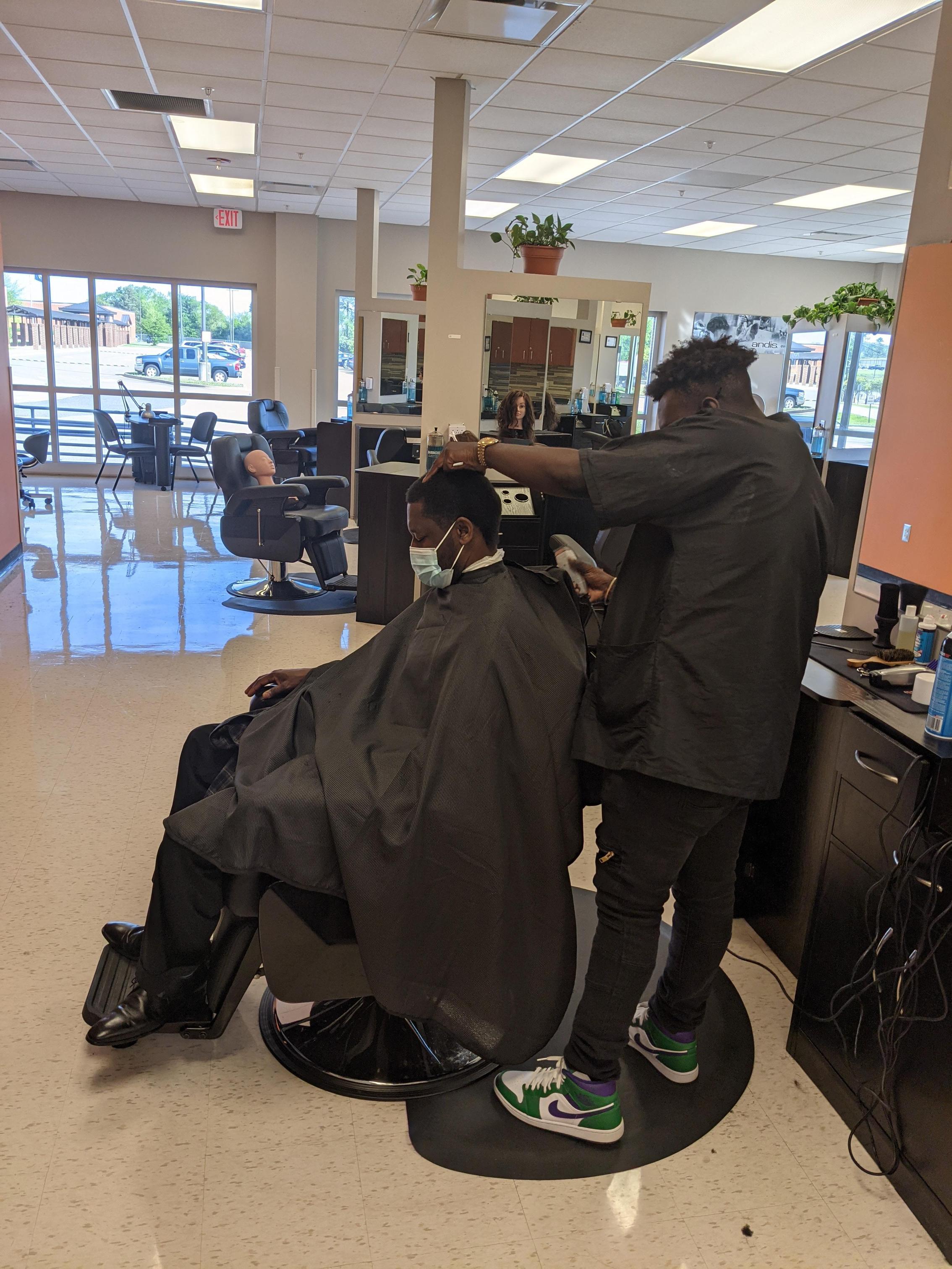 Student cutting Dr. Green hair.